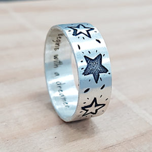 Stars engraved on ring