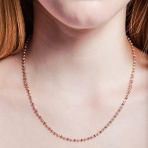 Rose gold and silver bead necklace